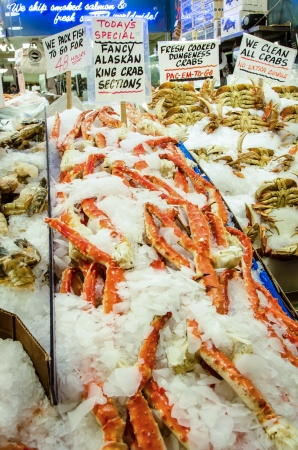 pike place: Seattle, United States - January, 4, 2014  A variety of shellfish on ice for sale at the Pike Place Market includes Alaska King Crab