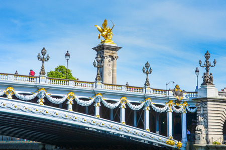 cherubs: Paris, France , May 29, 2011 - Pont Alexandre III spans the Seine River in Paris  The ornate bridge, with its exuberant Art Nouveau lamps, cherubs, nymphs and winged horses at either end, was completed in 1900 for the Universal Exhibition held in Paris  Editorial