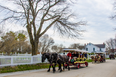 mackinac: Mackinac Island, United States, May 19, 2014 - Horse drawn carriages are the only forms of transportation on historic island community in Northern Michigan  Editorial
