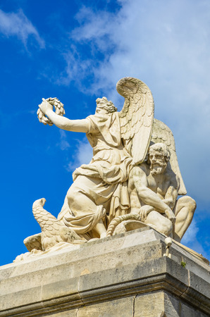 represents: The Allegory of Peace sculpture at the entrance of the Palace of Versailles represents the French victory over the Austrian Empire     Stock Photo