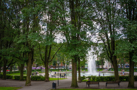 residents: Stockholm, Sweden, August 9, 2014 - A city park is popular with both residents and tourists.