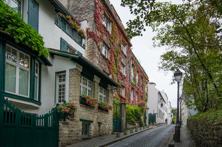 rue: Paris, France, October 10, 2014 - Rue Cortot is a narrow street in the historic district of Montmartre.