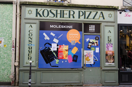 kosher: Paris, France, October 9, 2014 - The closing of a Kosher pizza restaurant is a sign of the times in the historic neighborhood of Marais.