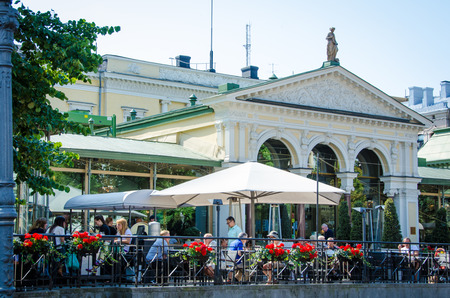 residents: Helsinki, Finland, August 8, 2014 ? Caf? scene in Esplanade Park in the heart of the Finnish capital which serves as a promenade for residents and tourists.