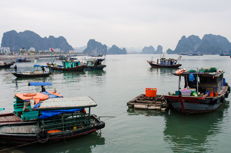 halong: Halong Bay, Vietnam, February 11, 2015 - Fishing boats in Halong Bay, a UNESCO World Heritage Site and one of the prime travel destinations in Vietnam.