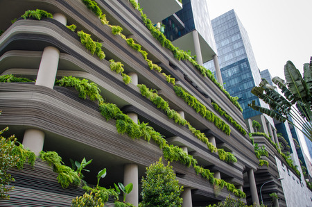 hotel building: Singapore, February 1, 2015 - PARKROYAL Hotel is a beautiful, award-winning eco-conscious building with lofty, lush tropical gardens on its balconies.