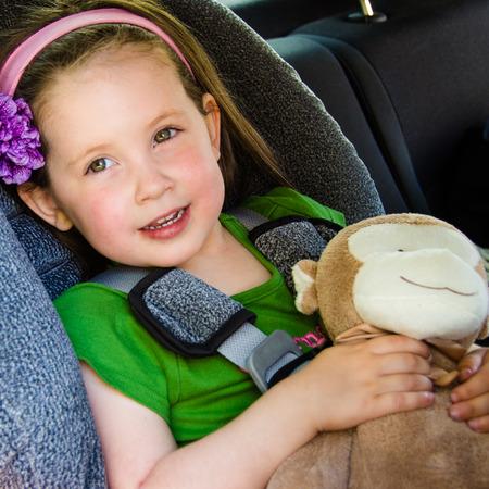 Pretty little girl safe in her car seat Reklamní fotografie - 40131048