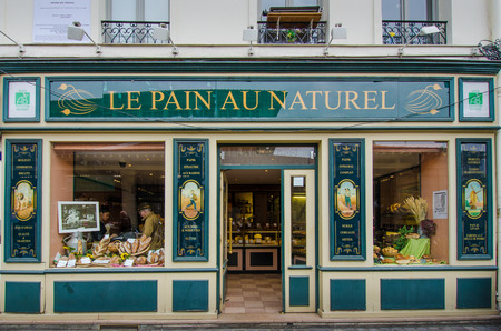 au: Paris, France, October 23, 2014 - People are shopping in a colorful bakery  called Le Pain Au Naturel.