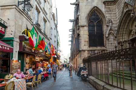 rue: Paris, France, October 25, 2014 - Outdoor cafes on Rue Saint-Severin in the Latin Quarter are popular with tourists. Editorial