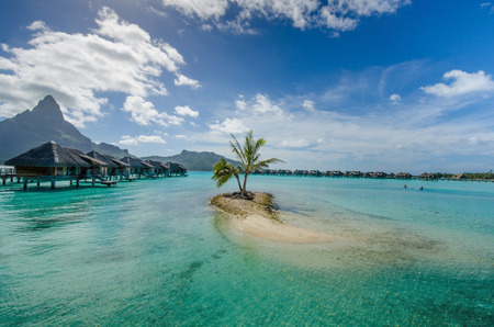otemanu: Overwater bungalows with view of Mount Otemanu on the island of Bora Bora Stock Photo