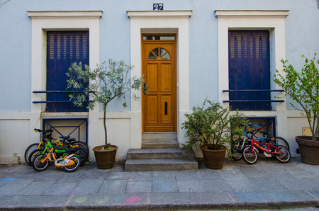 residential home: Paris, France, August 4, 2015 - Childrens bicycles are parked outside of their home on Rue Cremieux in the 12th Arrondissement, one of the prettiest residential streets in the city.