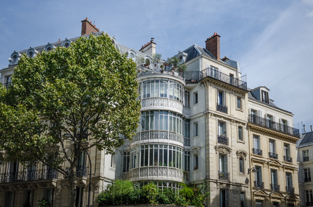 Paris, France, August 26, 2015  Ornate window treatment enhances the beauty of a historic residential building on Boulevard Malesherbes, a major artery inaugurated by Napoleon III in 1863.