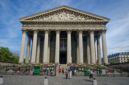 the madeleine: Paris, France, August 26, 2015 - La Madeleine is a Roman Catholic Church built in the Neo-Classical style as a temple to the glory of Napoleons army with 52 Corinthian columns.