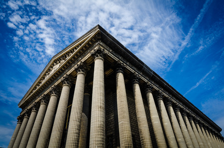 roman catholic: Paris, France, August 26, 2015 - La Madeleine is a Roman Catholic Church built in the Neo-Classical style as a temple to the glory of Napoleons army with 52 Corinthian columns.
