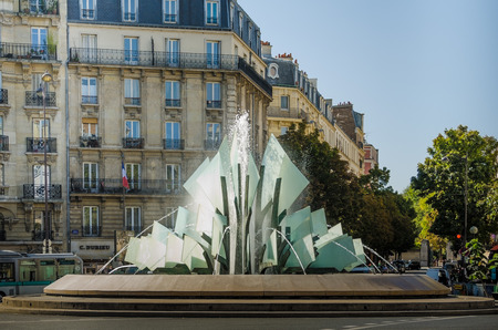sculpted: Paris, France, September 8, 2015 - The sculpted glass and steel fountain at Place Gambetta, was created in 1992 and stands in front of the city hall of the 20th arrondissement.