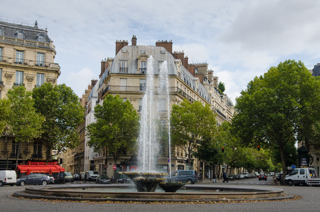 hugo: Paris, France, August 25, 2015 - Victor Hugo Plaza with its fountains honors Frances most important writer who became famous when he wrote The Hunchback of Notre-Dame published in 1831.