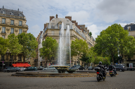 jorobado: Paris, France, August 25, 2015 - Victor Hugo Plaza with its fountains honors Frances most important writer who became famous when he wrote The Hunchback of Notre-Dame published in 1831.
