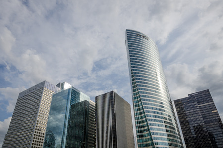 to dominate: Paris, France, August 11, 2015 - Modern glass and steel commercial office buildings dominate the skyline at the La Defense commercial and business center of the French capital.