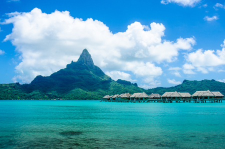 otemanu: Overwater bungalows with view of Mount Otemanu on the island of Bora Bora Stock Photo