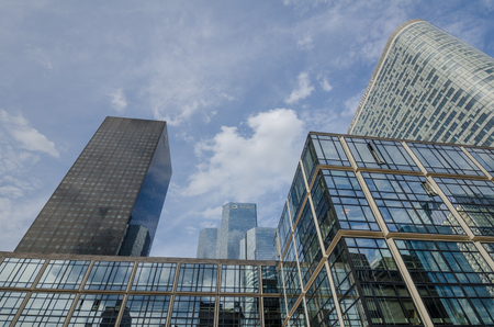 la defense: Paris, France, August 11, 2015 - Modern glass and steel commercial office buildings dominate the skyline at the La Defense commercial and business center of the French capital.