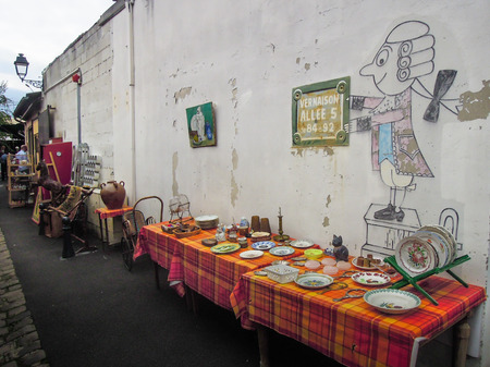 bargains: Paris, France, September 5, 2015 - Puces St. Ouen is a sprawling flea market with a hodgepodge of more than 2,000 vendors selling a wide range of goods including antiques.