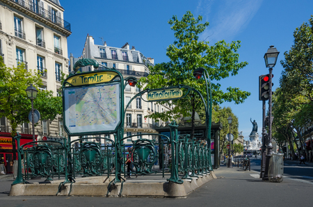 sculpted: Paris, France, August 29, 2015 - The Metro station at Temple is one of the few that have retained its original Art Nouveau sculpted entrance designed by architect Hector Guimard.