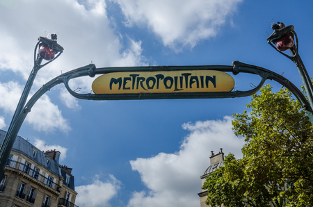 retained: Paris, France, August 28, 2015 - The Metro station at Wagram is one of the few that have retained its original Art Nouveau sculpted entrance designed by architect Hector Guimard.