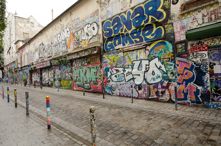 photos of pattern: Paris, France, September 12, 2015 - Rue Denoyez, with its abandoned storefronts, has been completely taken over by street artists bringing a kaleidoscope of ever changing murals on its walls. Editorial