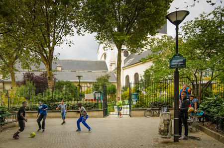 bastille: Paris, France September 5, 2015 - Boys play soccer at Esplanade Renee Labas, a small neighborhood park in the Bastille area.