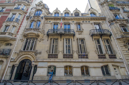 secondary school: Paris, France, August 28, 2015 - A student stands in front of Leonardo Da Vinci College, an Italian secondary school designed in 1899 by Jules Lavirotte, one of the best known Art Nouveau architects in the city.