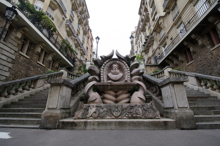 Paris, France, August 18, 2015 - Sculpture of the bust of Luis de Camos is part of an elaborate monument dedicated to the Portuguese poet which is located at the base of the stairs leading up to Avenue Camoens in the Passy neighborhood in Paris. Editorial