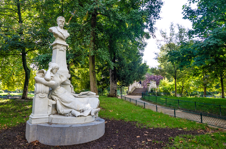 novelist: Paris, France, August 28, 2015  Monceau Park is one of the most beautiful in the city with dozens of white marble statues of famous French celebrities including novelist and poet Guy de Maupassant.