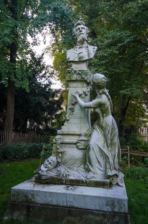 dramatist: Paris, France, August 28, 2015  Monceau Park is one of the most beautiful in the city with dozens of white marble statues of famous French celebrities including poet and dramatist Edouard Pailleron.