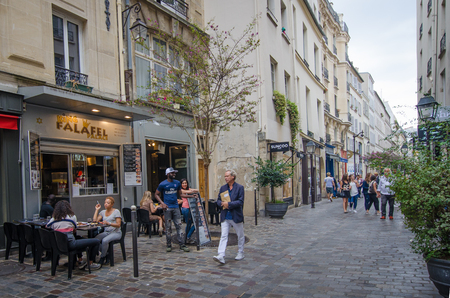 rue: Paris, France, August 31, 2015 - People gather on the corner of Rue des Rosiers and Rue des Ecouffes in the historic Jewish neighborhood of Marais. Editorial