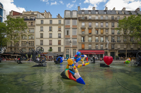 rite: PARIS - FRANCE SEPTEMBER 3, 2015: Historic homes overlook whimsical colorful sculptures at the Stravinsky Fountain next to Centre Pompidou represent the music of Igor Stravinskys The Rite of Spring. Editorial