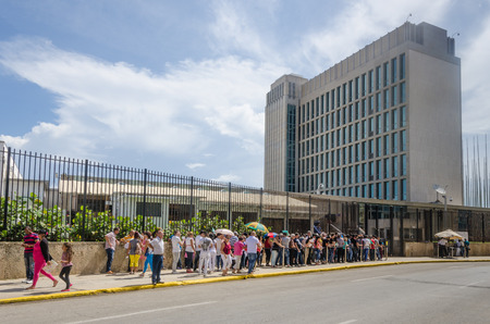 diplomatic: Havana, Cuba, June 20, 2016 - People line up outside the Embassy of the United States of America for consular services. The embassy was reopened when the United States and Cuba renewed diplomatic relations on July 20, 2015.