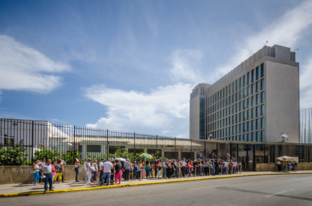 renewed: Havana, Cuba, June 20, 2016 - People line up outside the Embassy of the United States of America for consular services. The embassy was reopened when the United States and Cuba renewed diplomatic relations on July 20, 2015.