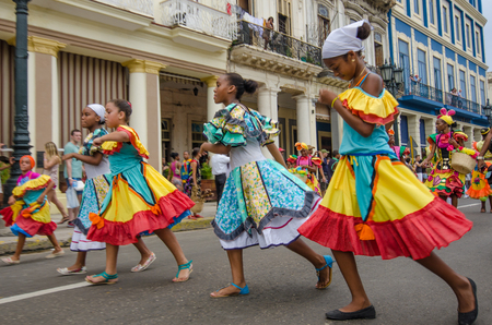 paseo: HAVANA - CUBA, JUNE 9, 2016: Dancers in colorful costumes celebrate Havana Day with a parade along Paseo de Marti in the historic La Habana Vieja neighborhood. Editorial