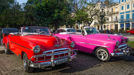 restored: HAVANA - CUBA JUNE 11, 2016: Close-up of two restored 1949 Chevrolet taxis waiting for passengers at Parque Central in the historic La Habana Vieja neighborhood. Editorial