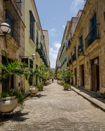 vieja: Havana, Cuba, June 13, 2016: Obrapia with its renovated homes and shops is one of the more attractive streets in the La Habana Vieja neighborhood.