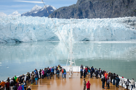 Glacier Bay, United States, September 11, 2016 - Cruise ship passengers get a close-up view of the majestic glaciers as they sail in Glacier Bay National Park and Preserve in Southeast Alaska, one of the world's largest protected natural areas.