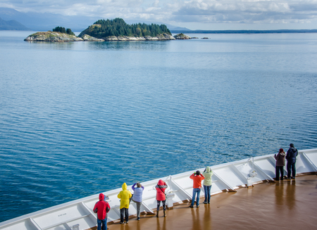 Glacier Bay, United States, September 11, 2016 - Cruise ship passengers look out for marine life while sailing in Glacier Bay National Park and Preserve in Southeast Alaska. Editorial