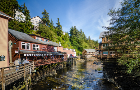 pilings: Ketchikan, Alaska, September 12, 2016 - Creek Street is a historic boardwalk perched on pilings along the banks of Ketchikan Creek and infamous for being the city's red light district. Today, the buildings house a variety of shops popular with tourists. Editorial