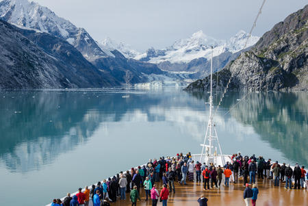 Glacier Bay, Alaska, September 11, 2016 - Cruise ship passengers get a close-up view of the majestic glaciers as they sail in Glacier Bay National Park and Preserve in Southeast Alaska, one of the world's largest protected natural areas.