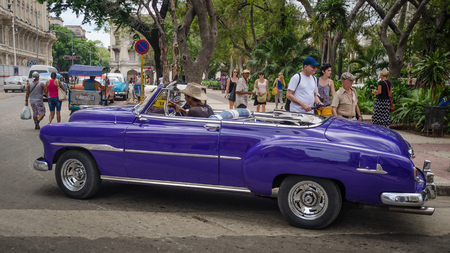 vieja: Havana, Cuba,  June 10, 2016 - Close-up of a purple 1949 Chevrolet convertible taxi cruising the streets around Parque Central in La Habana Vieja looking for passengers. Editorial