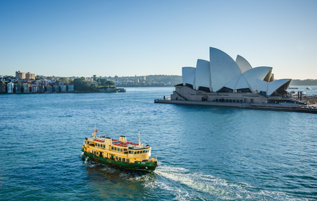 jorn: Australia, November 2, 2016 - A passenger ferry passes in front of the Sidney Opera House. a multi-venue performing arts center, designed by Danish architect Jorn Utzon.