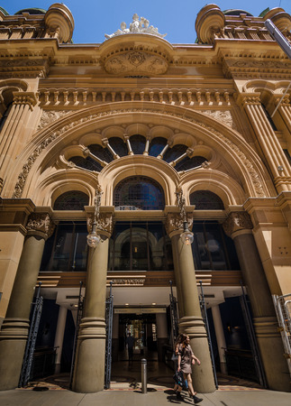 Sidney, Australia, November 4, 2016 - Shopper exits the Queen Victoria Building, an upscale shopping mall in the city center. The historic marketplace was restored in the mid-1980s.
