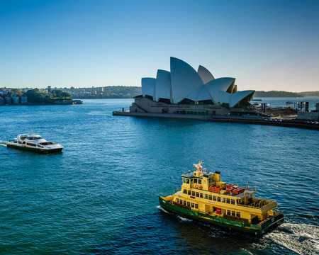 performing arts: Sidney, Australia, November 2, 2016 - Passenger ferries passes in front of the Sidney Opera House, a multi-venue performing arts center, designed by Danish architect Jorn Utzon. Editorial