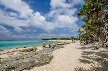 tourists stop: Mystery Island, Vanuatu, October 28, 2016 - Tourists walk along the beach of the uninhabited island of the Vanuatu archipelago of 82 volcanic islands in the South Pacific Ocean, a popular day stop for cruise ships.