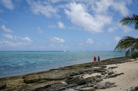 Mystery Island, Vanuatu, October 28, 2016 - Tourists walk along the beach of the uninhabited island of the Vanuatu archipelago of 82 volcanic islands in the South Pacific Ocean, a popular day stop for cruise ships.